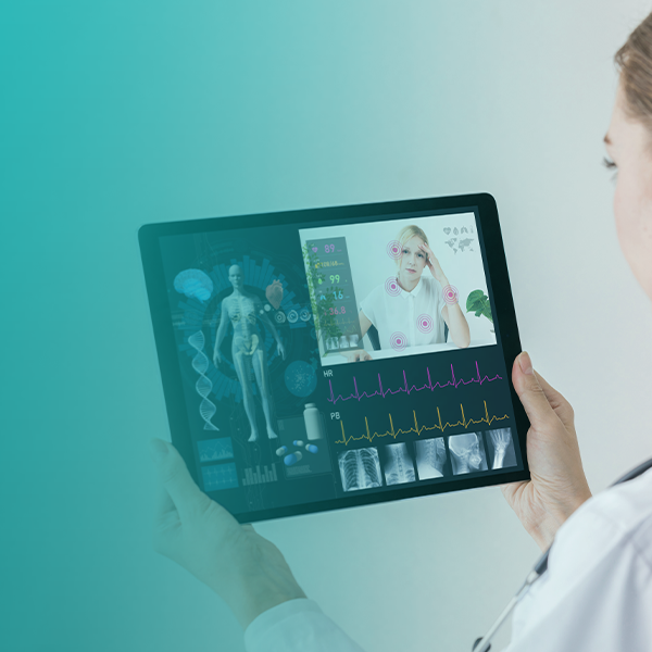 A nurse looking at tablet that is managed and secured by SOTI ONE Platform